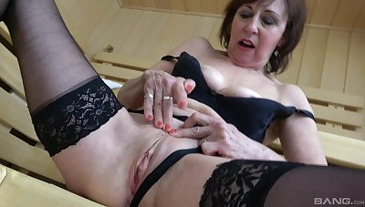 Foxy mature Dana in black skivvies drops on her knees to suck a dick
