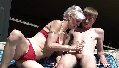 Freakish granny in handcuffs sucks a big hard penis be advisable for one young guy
