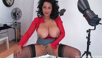 Smoking hot Danica Collins chaff surrounding her huge round boobs